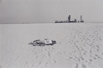Untitled (Long Beach, Woman on Beach with Buildings in Background)