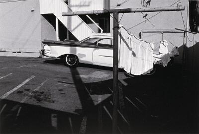 Untitled (Car Behind Laundry)